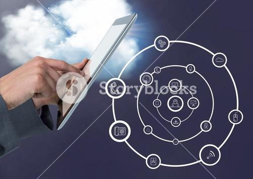 Man using digital tablet with digitally generated application icons