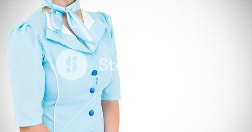 Mid section of air hostess