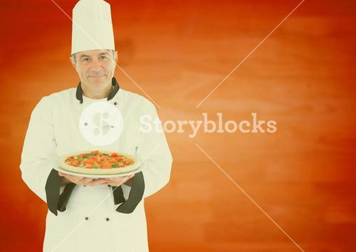 Smiling male chef presenting food in kitchen