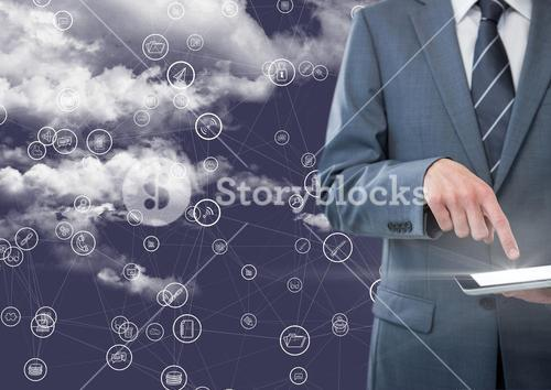 Businessman using digital tablet with connecting icons against blue background with clouds