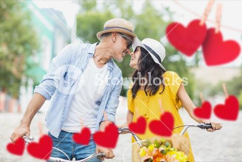 Romantic couple on bicycle looking face to face