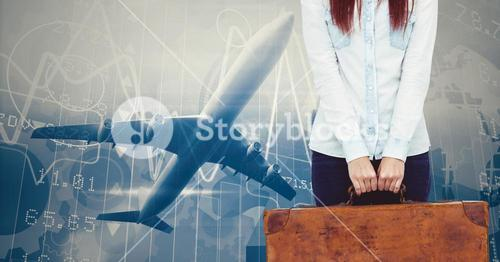 Mid section of woman holding a suitcase against digitally generated background