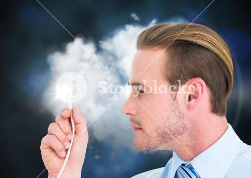 Businessman looking at cable with flare