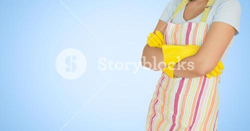 Woman in apron standing with arms crossed