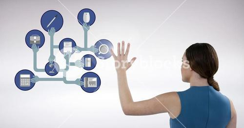 Businesswoman touching digitally generated connecting icons