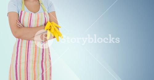 Mid section of female cleaner with yellow gloves