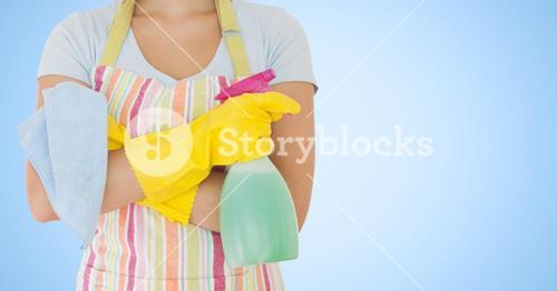 Mid section of female cleaner with spray bottle