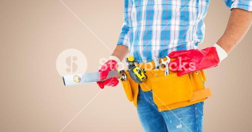 Mid section of handy man with tool belt