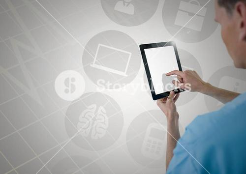 Doctor using digital tablet against digitally generated icons