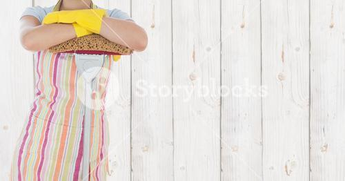 Cleaner standing with mop against wooden background