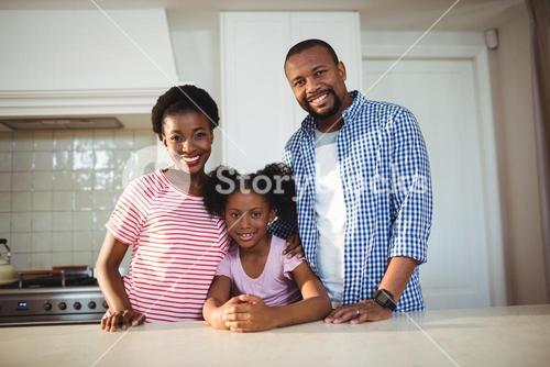 Portrait of parents and daughter in kitchen