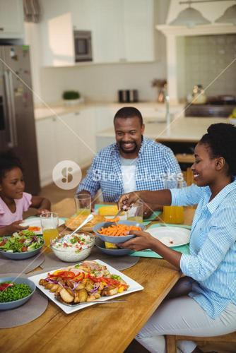 Family having meal on dinning table at home