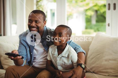 Son and father watching television