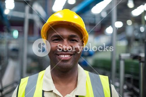 Portrait of smiling factory worker