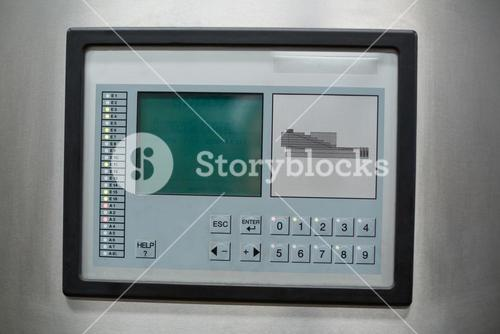 Control button and screen on factory machine