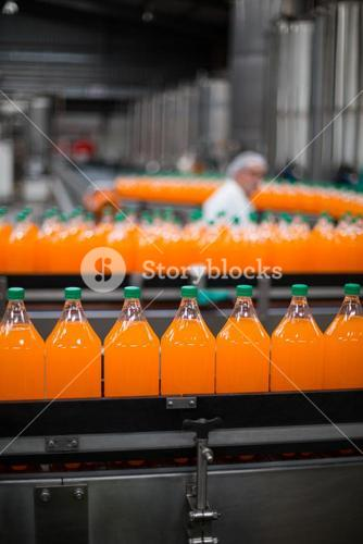 Bottle of juice processing on production line