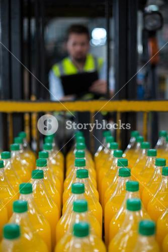 Close-up of juice bottles arranged in rows