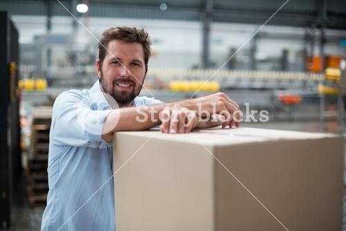Smiling factory worker standing in factory