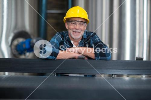 Male factory worker at drinks production factory
