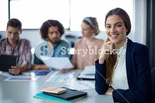 Portrait of female business executive sitting at desk