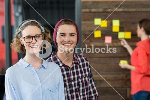 Smiling business executives standing in office