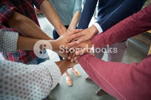 Team of businesspeople forming hand stack