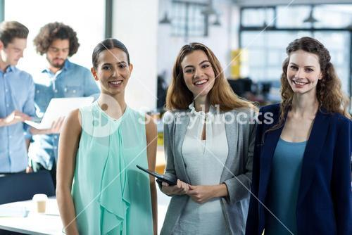 Portrait of smiling business executives at meeting