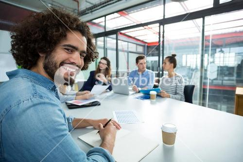 Portrait of smiling business executive in a meeting