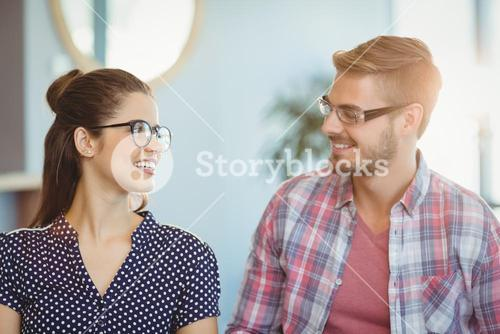 Smiling couple wearing spectacles