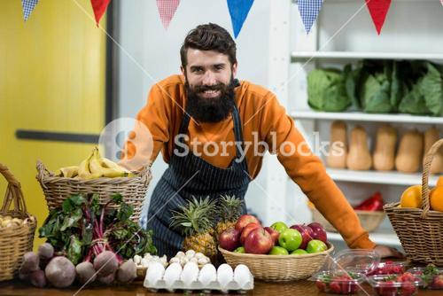 Vendor standing at the counter in grocery store