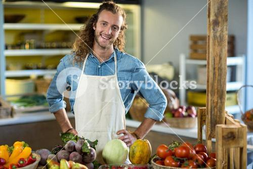 Vendor standing at the counter with hands on hips
