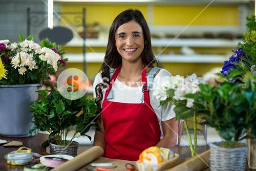 Smiling florist standing at the counter