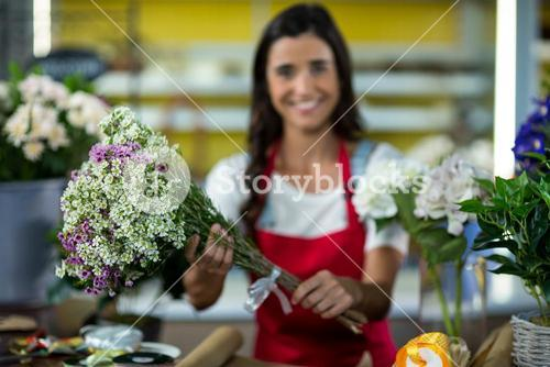 Florist offering flowers at the counter