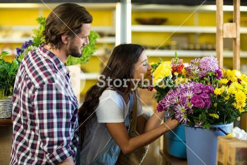 Couple purchasing flowers at florist shop