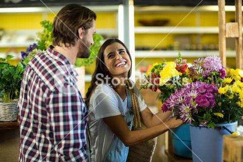 Couple selecting flowers in the florist shop