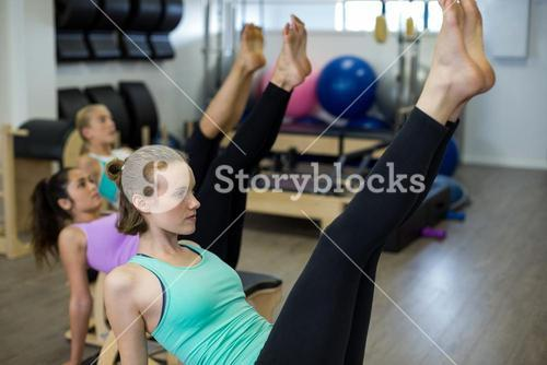 Fit woman exercising on wunda chair