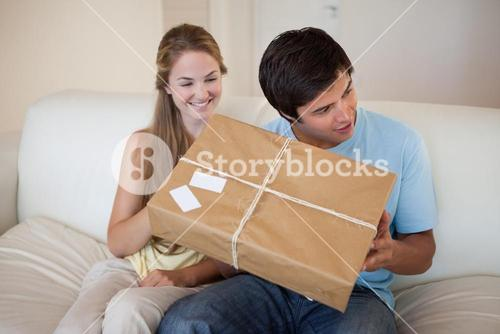 Smiling couple opening a package