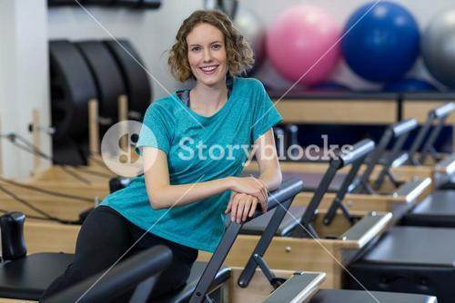 Portrait of woman relaxing on reformer