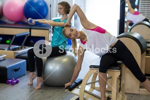 Woman exercising on reformer