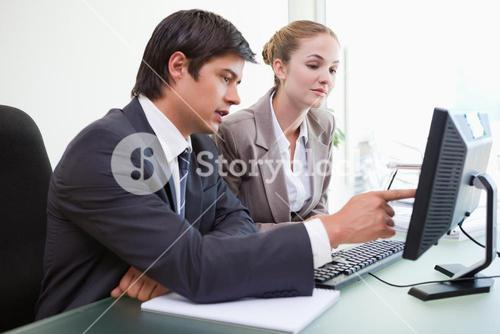 Good looking business people working with a computer