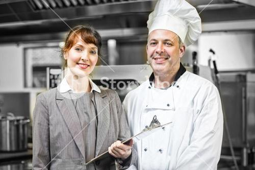 Mature head cook posing with female manager