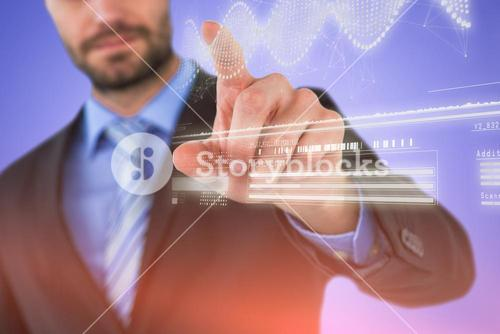 Composite image of businessman using imaginative digital screen