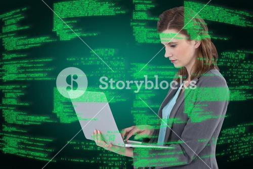 Composite image of businesswoman typing on laptop computer