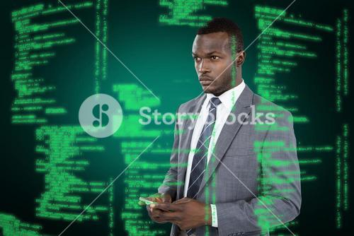 Composite image of businessman holding mobile phone