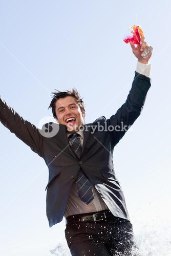 Portrait of a businessman jumping in a swimming pool