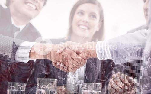 Smiling business people closing a deal