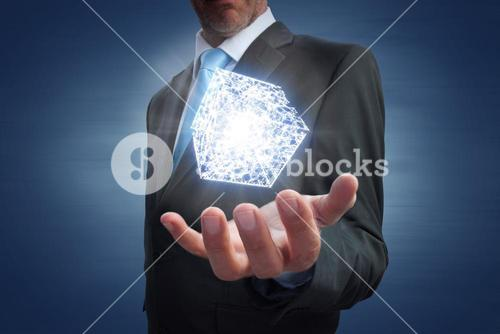 Composite image of businessman showing his empty hand
