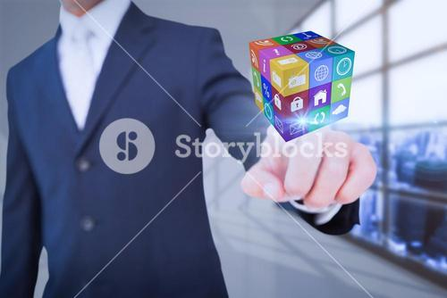 Composite image of smiling businessman in suit pointing