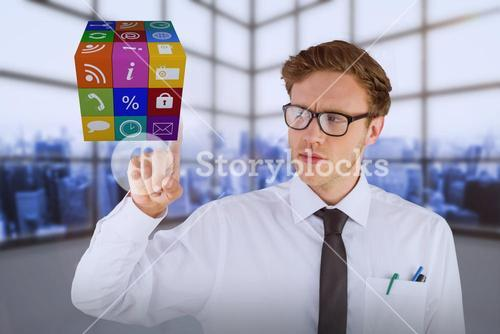 Composite image of geeky businessman smiling and pointing cube