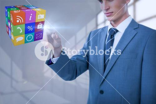 Composite image of midsection of elegant businessman pointing cube